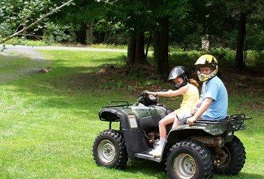 Kids on a Honda Racher 4x4 ATV